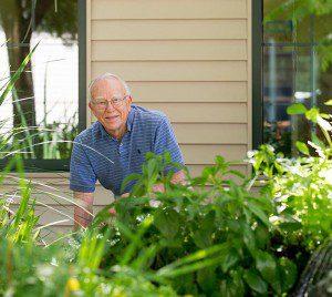 resident in garden with shovel