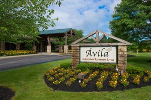 Avila entrance stone and sign with flowers in bloom