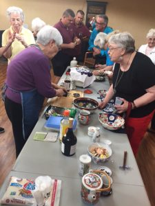 Residents learning how to make sushi from fellow resident at Ávila