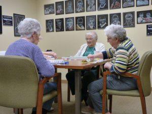 Ladies playing mah jong