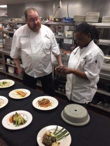 chef and staff preparing dinner
