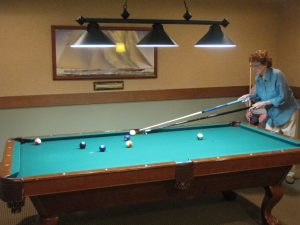 Resident playing billiards