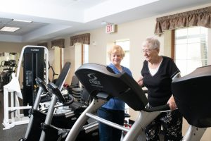 Avila's Fitness Rehab Specialist working with resident
