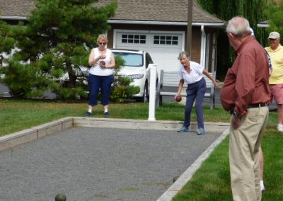 Active seniors playing bocce ball at Avila Retirement Community