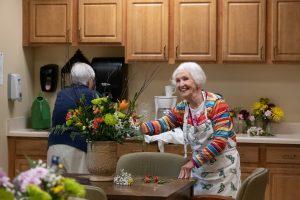 smiling resident arranging flowers