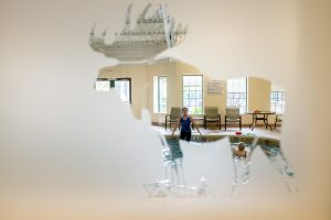 view through frosted glass of trainer at pool