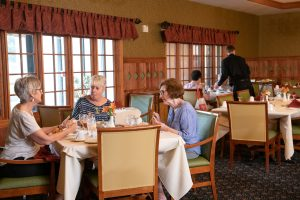 residents having lunch in main dining cafe