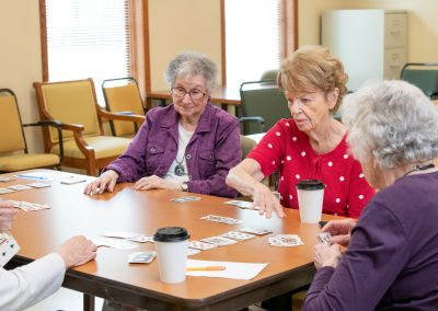 4 ladies playing poker