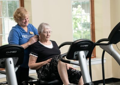 rehab specialist with resident on bike