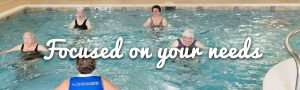 focused on your needs with residents in pool exercising