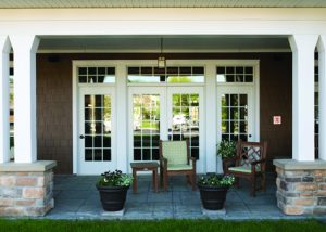 Front Porch the Lodge with chairs and flower pots
