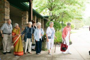 Senior residents boarding the bus to go shopping
