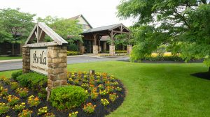 Avila Grand Lodge entrance with flowers in bloom