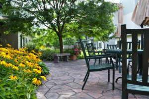Grand Lodge patio with waterfall and flowers in bloom